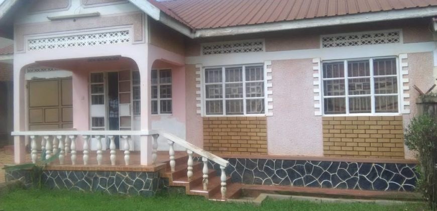 Two bed room house, sitting room, dining with a huge garage and developed neighborhood